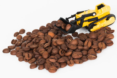In the photo you see a toy bulldozer that rakes coffee beans.