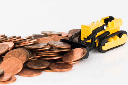 In the photo you see a toy bulldozer that rakes coins.