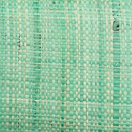 In the photo you see the texture of a green canvas bag. 스톡 콘텐츠