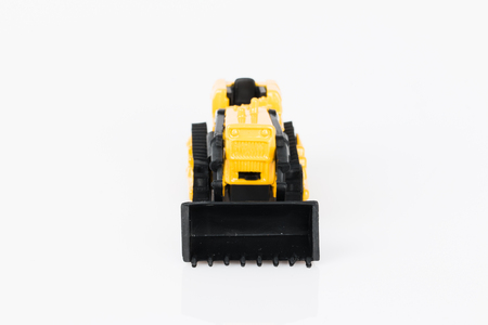 In the photo you see a toy bulldozer.