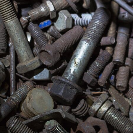 The photo shows a buch of old dirty bolts. 스톡 콘텐츠