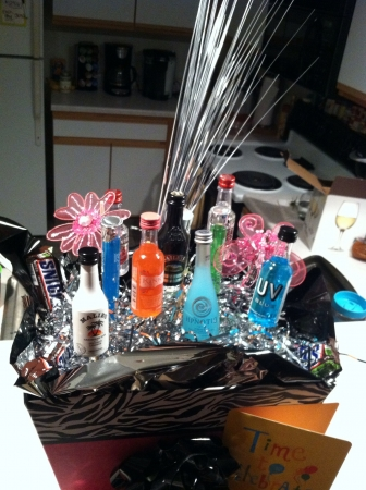 21st birthday gift basket with alcohol bottles.