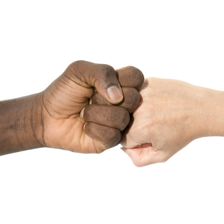 brotherhood: Mixity - Two joint hands symbolizing diversity Stock Photo