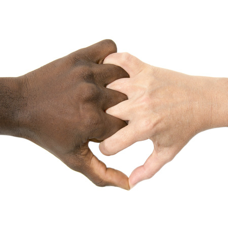racism: Mixity - Two joint hands symbolizing diversity Stock Photo
