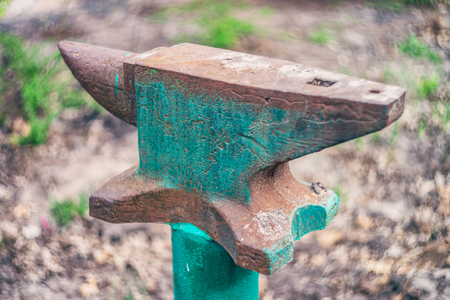 Old anvil outdoor photo. Stock Photo