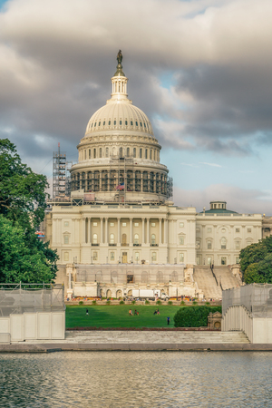 WASHINGTON DC, USA - AUGUST 5, 2016: The United States Capitol view from the street. In 2014, scaffolding was erected around the dome for a restoration project scheduled to be completed by 2017.