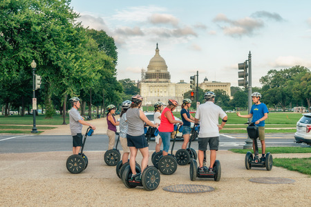 WASHINGTON DC, USA Riders on segway on the Capitol Hill. The name Segway is derived from the word segue, meaning smooth transition.