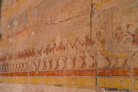 LUXOR, EGYPT: Ancient Deir el-Bahari or Dayr al-Bahri is a complex of mortuary temples and tombs located on the west bank of the Nile, opposite the city of Luxor, Egypt. Stock Photo