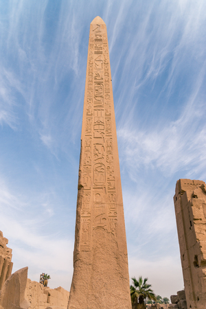 LUXOR, EGYPT: Ancient ruins of Karnak temple in Egypt at noon. The complex is a vast open-air museum, and the second largest ancient religious site in the world