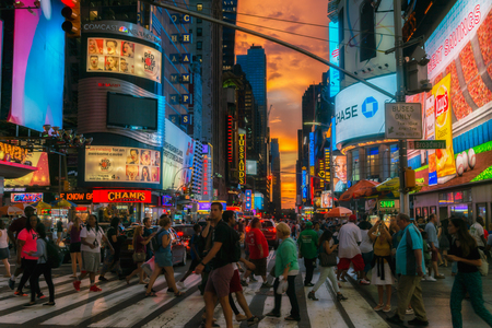 NEW YORK CITY, USA: Buildings and street life on the Times Square - one of the worlds most visited tourist attractions, drawing an estimated 50 million visitors annually. Lowlight. Editorial