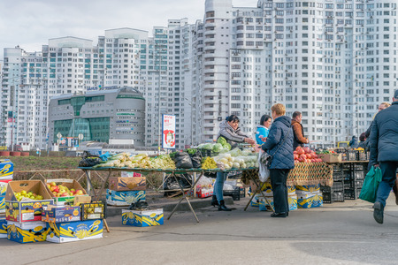 KYIV, UKRAINE - MARCH 15, 2017: People on local market near metro station Poznyaky, Kyiv. Ukraine is agricultural country. Editorial