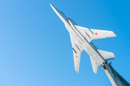 mig: Soviet Air jet model on concrete basement with blue sky background, sunny weather