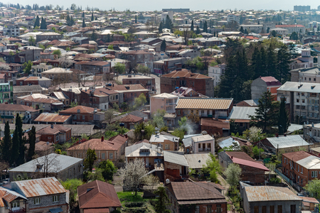 kutaisi: Panorama view on Kutaisi city, Georgia with mountains .Vivid image. Stock Photo