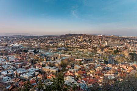 Panorama of Tbilisi, Georgia in sunset rays.