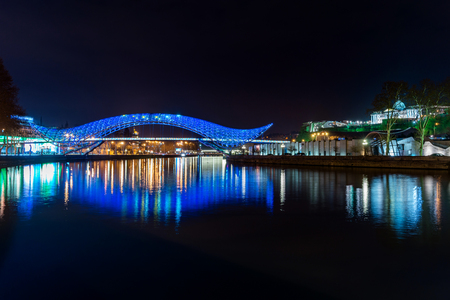 leds: The Bridge of Peace is a bow-shaped pedestrian bridge, a steal and glass construction illuminated with numerous LEDs, over the Kura River in downtown Tbilisi, capital of Georgia.
