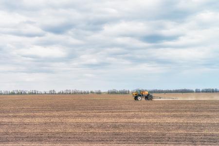Tractor preparing the field before seeding the ground in Ukraine