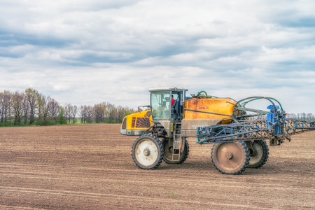 seeding: Tractor preparing the field before seeding the ground in Ukraine