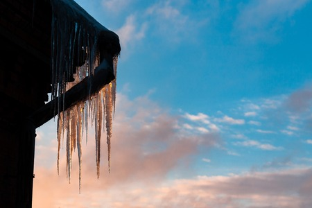 icicle on the edge of the roof with sky background Stok Fotoğraf