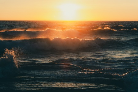 Monstrous sea storm waves in sunset warm rays Stok Fotoğraf