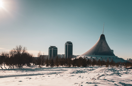 ASTANA, KAZAKHSTAN - FEBRUARY 14, 2019: View on cityscape buildings in sunset light with the blue sky background