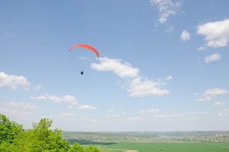 high flier: Paragliding in the valley at mountain Karatchoun.
