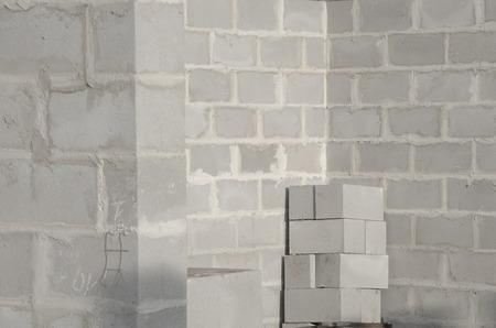 concrete block: New house construction, building foundation walls using concrete blocks, copy space