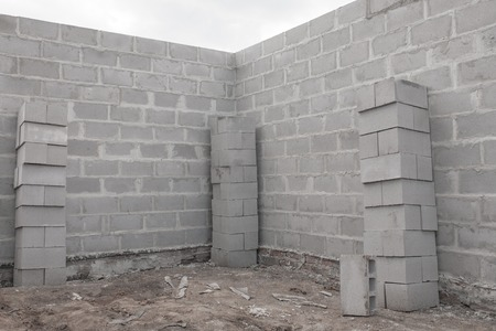 stonemason: Stack of cement blocks at the construction site. Stock Photo