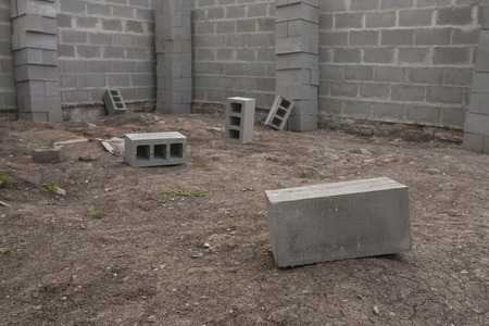 building block: gray cinder blocks at a construction site background