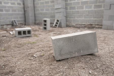 cinder: gray cinder blocks at a construction site background