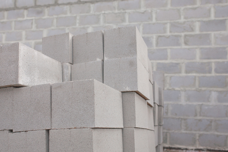 building block: Stack of cement blocks at the construction site. Stock Photo