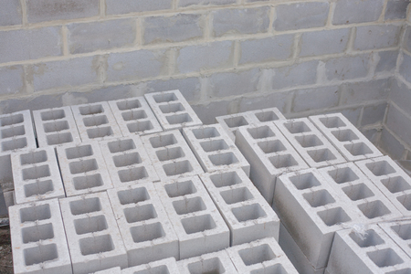 stonemason: Stack of cement blocks at the construction site