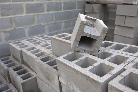 cinder: Stack of cement blocks at the construction site. cinder blocks background