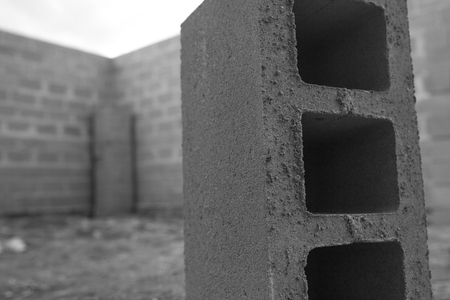 building foundation: New house construction, building foundation walls using concrete blocks, copy space. black and white photo Stock Photo