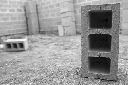 building foundation: New house construction, building foundation walls using concrete blocks, copy space. black and white photo.