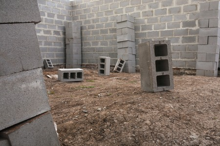 building foundation: New house construction, building foundation walls using concrete blocks, copy space.
