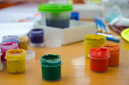 hobby painting - workplace with colored pencils, gouache jars
