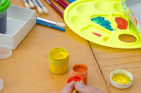 gouache: hobby painting - workplace with colored pencils, gouache jars