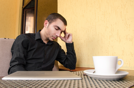 exhausted worker: portrait of exhausted worker sleeping on his desktop Stock Photo