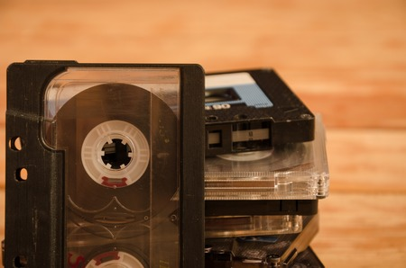 cassettes: Old audio cassettes on wooden background. music abstract