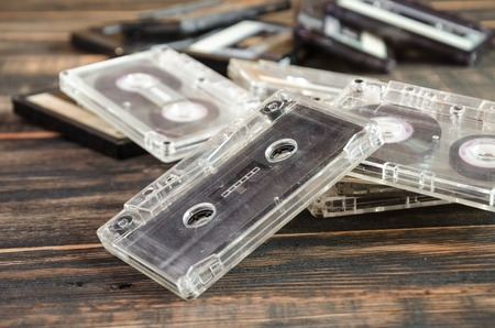 sound box: Old audio cassettes on wooden background. music abstract