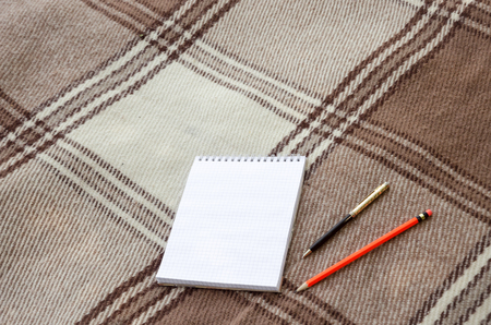 coverlet: notebook with pencil and notes on coverlet in flat lay
