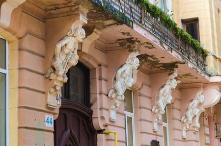 Vintage detail of carved stone work look like devil