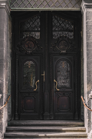 door knob: Antique vintage entrance door to the old church. Stock Photo