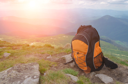 backpack in the mountains on a sunny summer day 스톡 콘텐츠