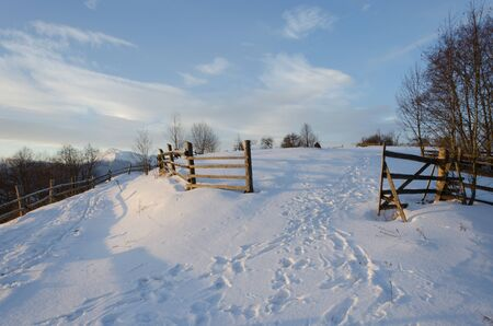 beautiful winter landscape in mountains at sunrise.
