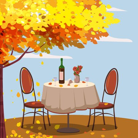 Autumn cafe table with wine for two persons autumn branches of falling leaves foliage, chairs flowers in park romantic mood.