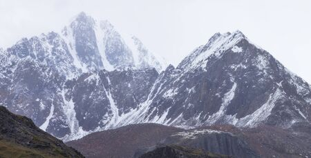 Snow-capped peaks in natural light. Mountain tourism and mountaineering.
