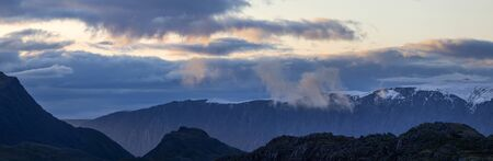 Panoramic view of the mountains, morning light. Severe weather.
