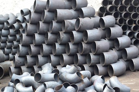 laborious: Pipes and bends steel Stock Photo