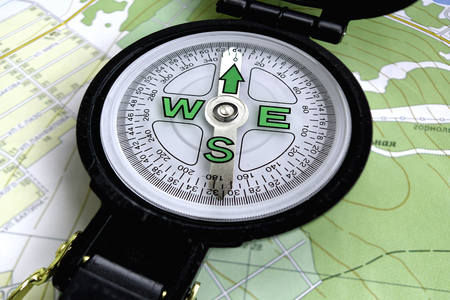 azimuth: a compass and a map Stock Photo